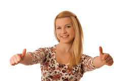 Cute blond woman showing thumbs up as gesture for success isola stock images