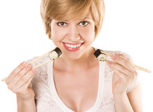 Cute blond woman with sushi and roll Stock Image