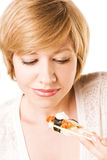 Cute blond woman with sushi and roll Stock Photos
