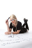 Cute blond woman thinking on graph Royalty Free Stock Image