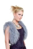 Cute blond woman wearing a purple dress a fur vest Royalty Free Stock Photo