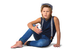Cute blonde agresivny boy or teenager in full Royalty Free Stock Photo