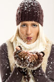 Cute Blonde Blowing Snowflakes Royalty Free Stock Photos