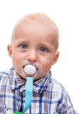 Cute blonde blue-eyed little boy with a pacifier Stock Image