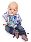 Cute blonde blue-eyed little boy with a pacifier Stock Photos