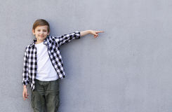 Cute blonde boy in casual clothes Stock Photography