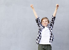 Cute blonde boy in casual clothes Royalty Free Stock Image