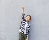 Cute blonde boy in casual clothes Royalty Free Stock Images
