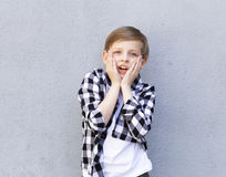 Cute blonde boy in casual clothes Royalty Free Stock Photography