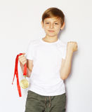 Cute blonde boy with gold medal Royalty Free Stock Image