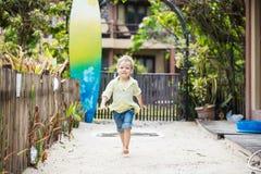 Cute blonde boy walking barefoot Stock Image