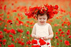 Child girl with bouquet of poppies Stock Photos