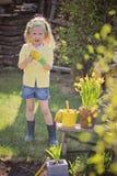 Cute blonde child girl having fun playing little gardener Royalty Free Stock Images