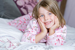 Cute Blonde Child Lying on her Bed royalty free stock photo