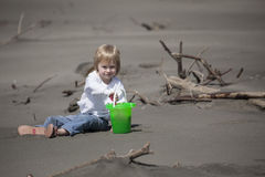 Cute Blonde Child Playing at the Beach Stock Photography