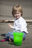Cute Blonde Child Playing at the Beach Stock Images