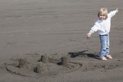 Cute Blonde Child Playing at the Beach Royalty Free Stock Image
