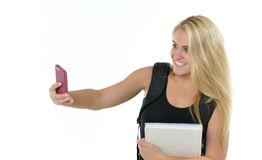 Cute blonde female student takes a selfie Stock Photo