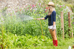 Cute blonde gardening on sunny day Stock Photography