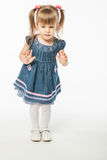 Cute blonde girl in blue dress Royalty Free Stock Photography