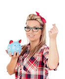 Cute Blonde Girl with a blue money box Stock Photo
