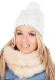 Cute Blonde Girl with coats winter clothes Royalty Free Stock Image