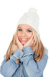 Cute Blonde Girl with coats winter clothes Stock Images