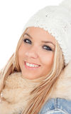 Cute Blonde Girl with coats winter clothes Royalty Free Stock Photos