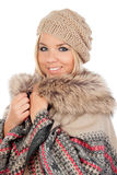 Cute Blonde Girl with coats winter clothes Stock Photography