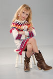 Cute blonde girl in colorful clothes Royalty Free Stock Image