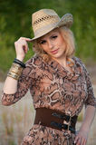 Cute blonde girl in a cowboy hat. Stock Image
