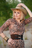 Cute blonde girl in a cowboy hat.  Stock Photography