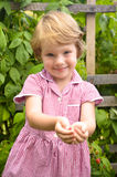 Cute, blonde girl in the garden Royalty Free Stock Images