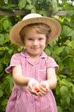 Cute, blonde girl in the garden Royalty Free Stock Photos