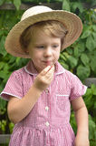 Cute, blonde girl in the garden Royalty Free Stock Image