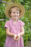 Cute, blonde girl in the garden Stock Photography