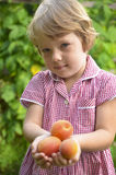 Cute, blonde girl in the garden Royalty Free Stock Photography