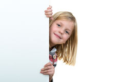 Cute blonde girl holding a blank sign.  Royalty Free Stock Photography