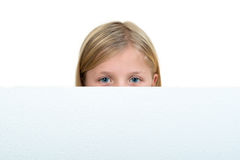 Cute blonde girl holding a blank sign.  Royalty Free Stock Images