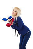 Cute blonde girl holding shoes Stock Images