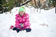 Cute blonde girl making snowball Royalty Free Stock Photography