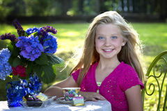 Cute blonde girl at outdoor tea party Royalty Free Stock Images