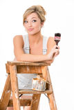 Cute blonde girl, in overalls, resting on old ladder Royalty Free Stock Photography