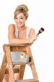 Cute blonde girl, in overalls, resting on old ladder Stock Images