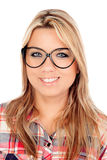 Cute Blonde Girl with plaid shirt and glasses Stock Photos