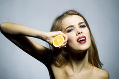 Cute blonde girl portrait with orange Royalty Free Stock Photos