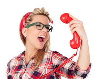 Cute Blonde Girl shouting at phone Royalty Free Stock Photos