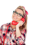 Cute Blonde Girl talking on the phone Royalty Free Stock Images