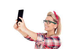 Cute Blonde Girl talking on the phone Royalty Free Stock Image