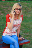 Cute Blonde Girl Talking On Phone Stock Photography